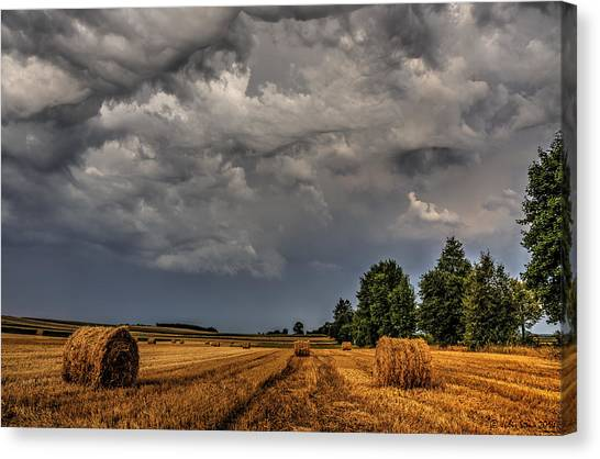 Storm Clouds Over Harvested Field In Poland 2 Canvas Print