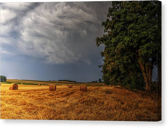 Storm Clouds Over Harvested Field In Poland Canvas Print