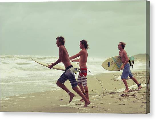 Surfboard Canvas Print - Storm Surfers by Laura Fasulo