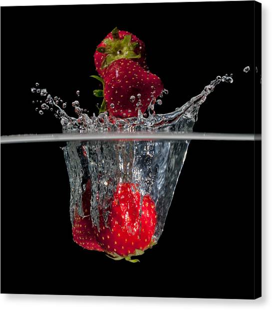 Strawberries Splashing In Water Canvas Print