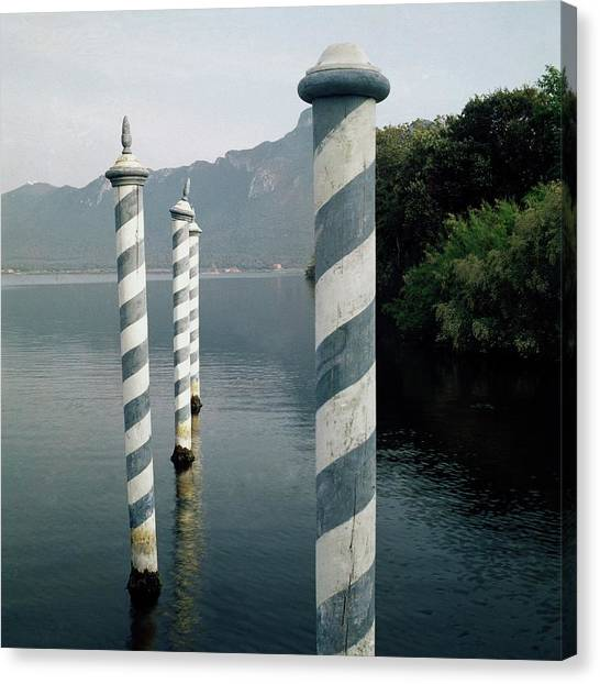 World Heritage Site Canvas Print - Striped Posts In The Grand Canal by Leombruno-Bodi