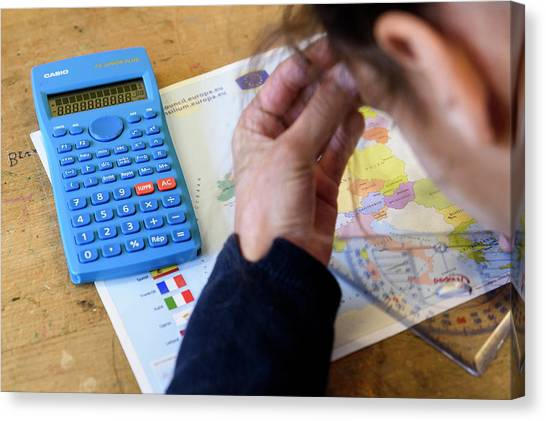 Protractors Canvas Print - Student With A Calculator by Jmquinet/reporters/science Photo Library