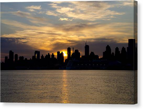 City Sunrises Canvas Print - Sun Comes Up On New York City by Bill Cannon