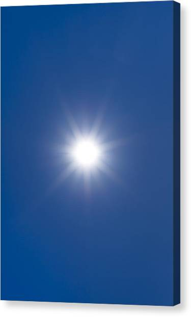 Sun In A Blue Sky Canvas Print by Science Photo Library