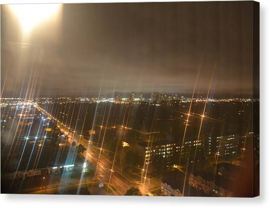 Sun Over City Lights Canvas Print by Naomi Berhane