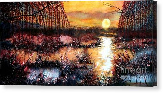 Sun Sets On The Marsh Canvas Print by Janine Riley