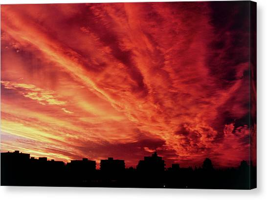 Sunset Horizon Canvas Print - Sun Setting Behind Cloud Over Buildings by Pekka Parviainen/science Photo Library