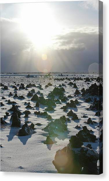 Sun Shining On A Field Of Lava Rocks Canvas Print by Thomas Kokta
