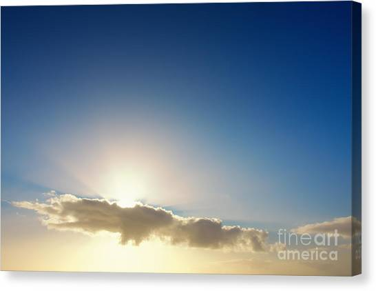 Sunbeams Behind Clouds Canvas Print