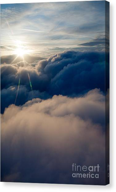 Sunburst Above The Clouds Canvas Print