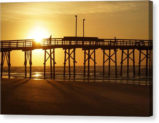Beach Sunrises Canvas Print - Sunrise At The Jolly Roger Pier 2 by Mike McGlothlen