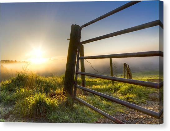 Mountain Dew Canvas Print - Sunrise  Gate by Debra and Dave Vanderlaan
