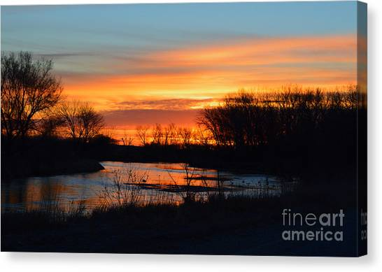 Sunrise On The River Canvas Print