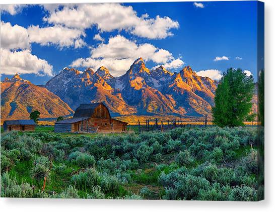 Canvas Print featuring the photograph Sunrise On The Tetons Limited Edition by Greg Norrell