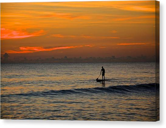 Sunrise Paddling Canvas Print by Cloe Couturier