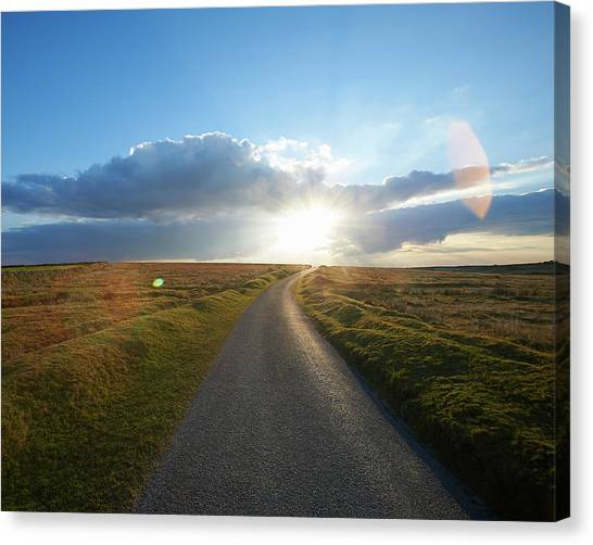 Sunset At End Of Long Country Road Canvas Print by Dougal Waters