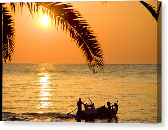 Beach Sunrises Canvas Print - Sunset  Boat At Sea And Palm Tree by Raimond Klavins