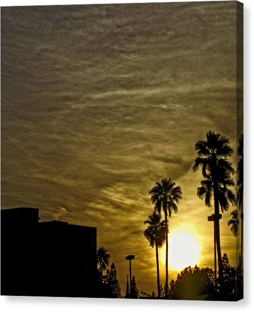 Sunset Clouds Canvas Print by Marquis Crumpton