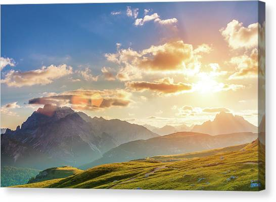 Sunset In The Mountains Canvas Print by Peter Zelei Images