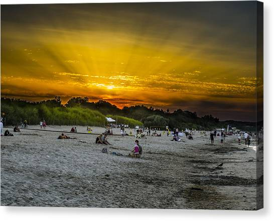 Sunset On The Crowded Beach Canvas Print by Adam Budziarek