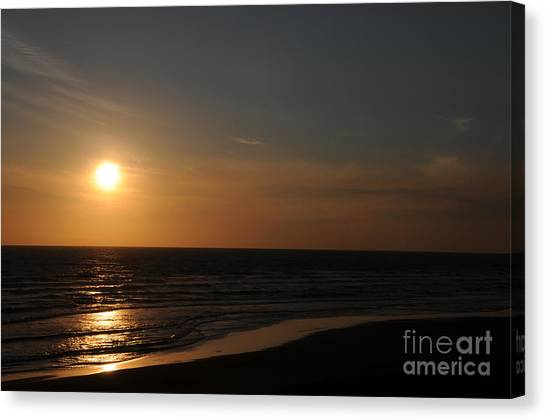 Sunset Over Calm Waters Canvas Print