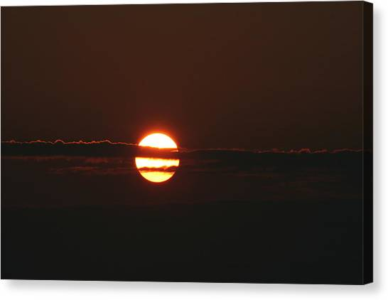 Sunset With Cloud Canvas Print by Carolyn Reinhart