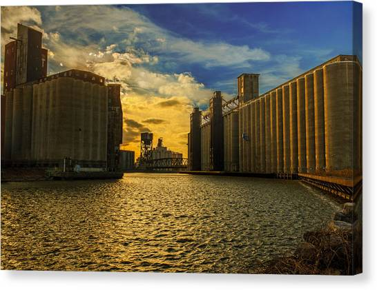 Sunsets On A River Through An Industrial Canyon Canvas Print