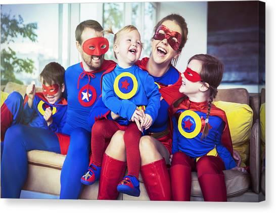 Superhero Family Laughing On Sofa Canvas Print by Robert Daly