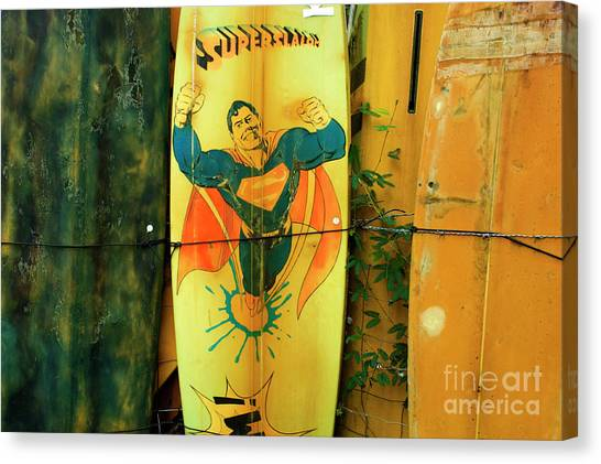 Surfboard Fence Canvas Print - Superman Surfboard by Bob Christopher