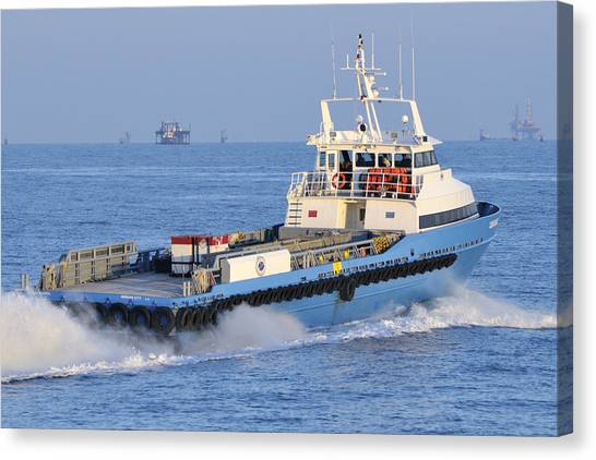 Supply Vessel Heads To Sea Canvas Print