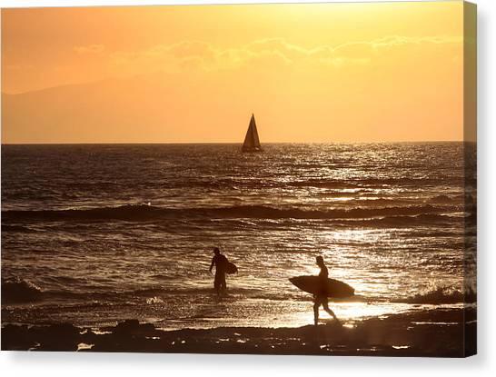 Canvas Print featuring the photograph Surfer At Sunset by Georgi Djadjarov