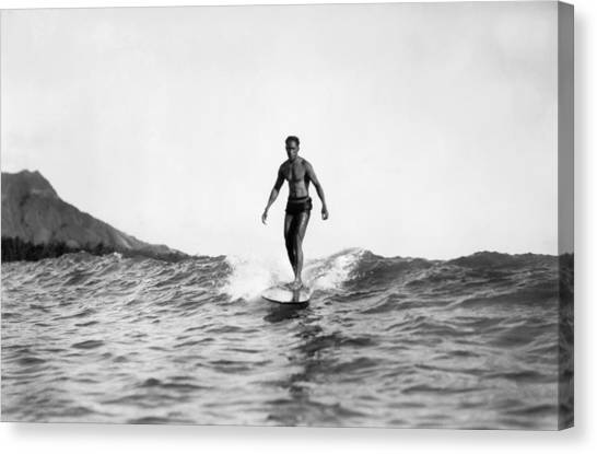 Surfboard Canvas Print - Surfing At Waikiki Beach by Underwood Archives