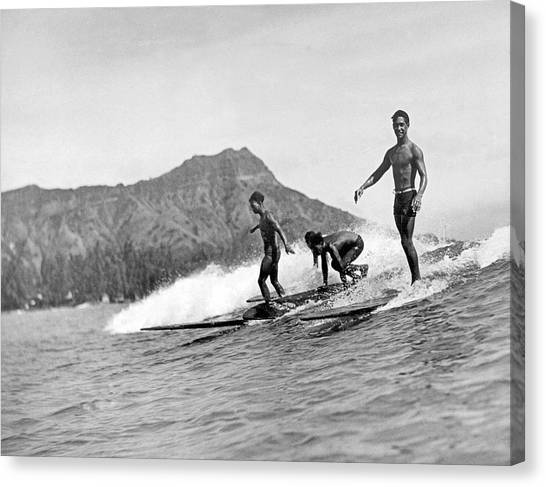 Surfboard Canvas Print - Surfing In Honolulu by Underwood Archives