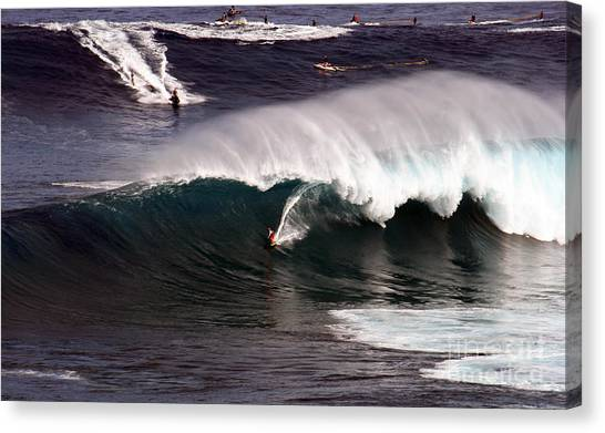 Surfing Jaws Maui  Canvas Print by Paul Karanik