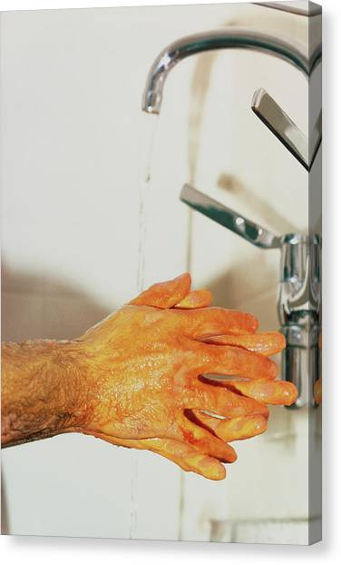 Surgeon Scrubbing Up Canvas Print by Andrew Mcclenaghan/science Photo Library