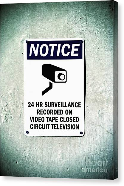 Canvas Print featuring the photograph Surveillance Sign On Concrete Wall by Bryan Mullennix