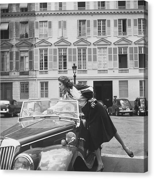 Chanel Canvas Print - Suzy Parker Outside The French Vogue Office by Jacques Boucher