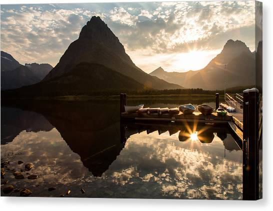Swiftcurrent Lake Boats Reflection And Flare Canvas Print