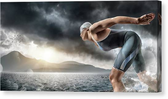 Swimmer About To Dive In Sea Canvas Print by Peepo