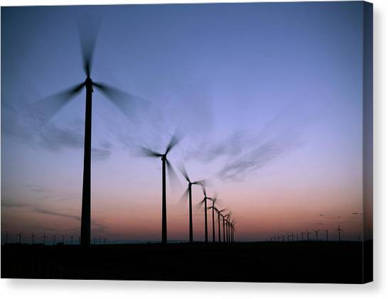 Prairie Sunsets Canvas Print - Tall Windmills Are Silhouetted by Todd Korol