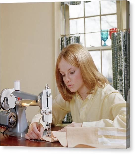 Copy Machine Canvas Print - Teen Girl Using Sewing Machine by Vintage Images