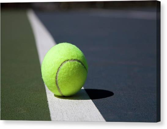 Tennis Ball On A Line In A Court Canvas Print