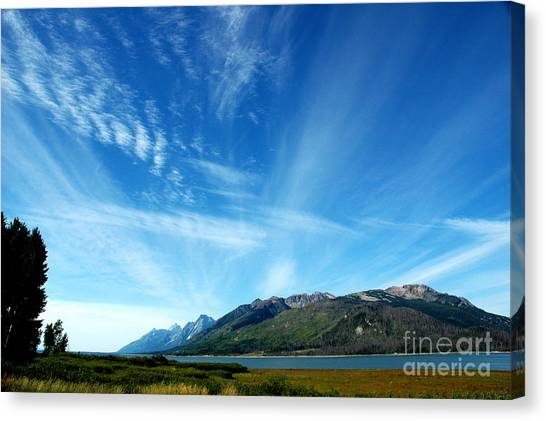 Tetons Sky Canvas Print by Alan Russo