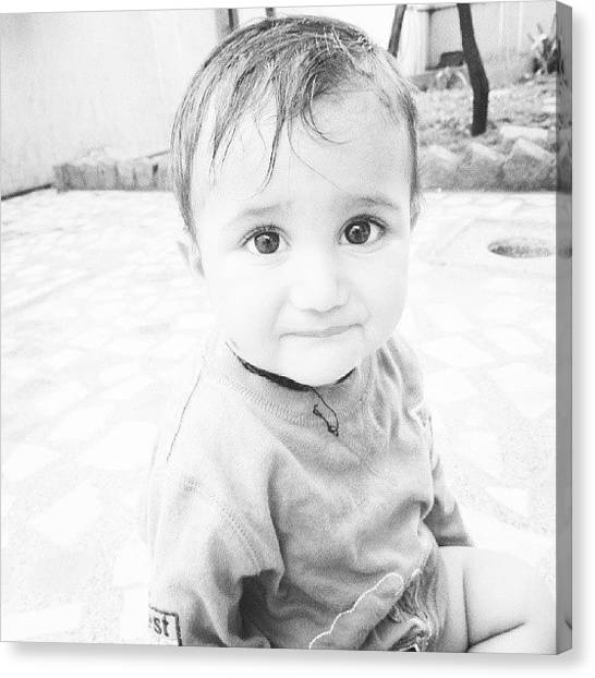 Innocent Canvas Print - That Innocent Face And Those Curious by Vinit Jain