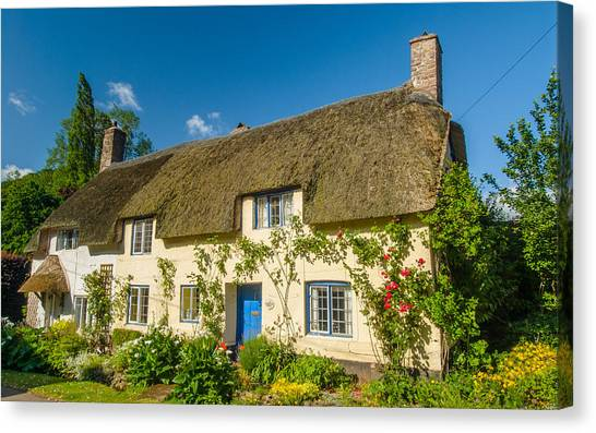 Thatched Cottage In Dunster Somerset Canvas Print by David Ross