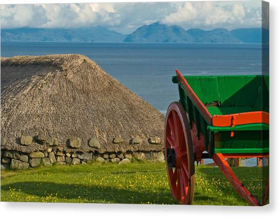 Thatched Cottage In Kilmuir Isle Of Skye Canvas Print by David Ross
