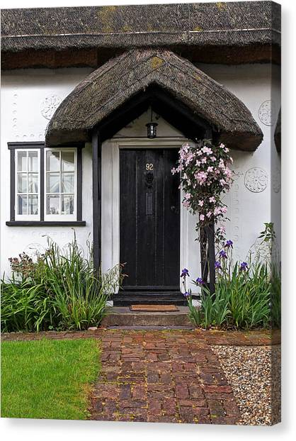 Thatched Cottage Welcome Canvas Print by Gill Billington