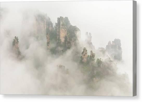Foggy Canvas Print - The Foggy Peaks by David Hua