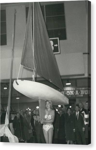The Girl With A Boat On Her Shoulder. It Weigh Only 40 Les Canvas Print by Retro Images Archive