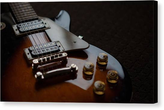 The Guitar Canvas Print by Dasmin Niriella